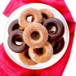 gluten-free baked pumpkin donuts, baked pumpkin donuts, baked pumpkin doughnuts, cakey donuts, cake donuts, cake doughnuts, holiday baking, holiday desserts, thanksgiving desserts, Christmas desserts, hollowed desserts, pumpkin, pumpkin cake, pumpkin desserts, pumpkin recipes, pumpkin and chocolate, chocolate, chocolate glaze, chocolate ganache, itsrainingflour