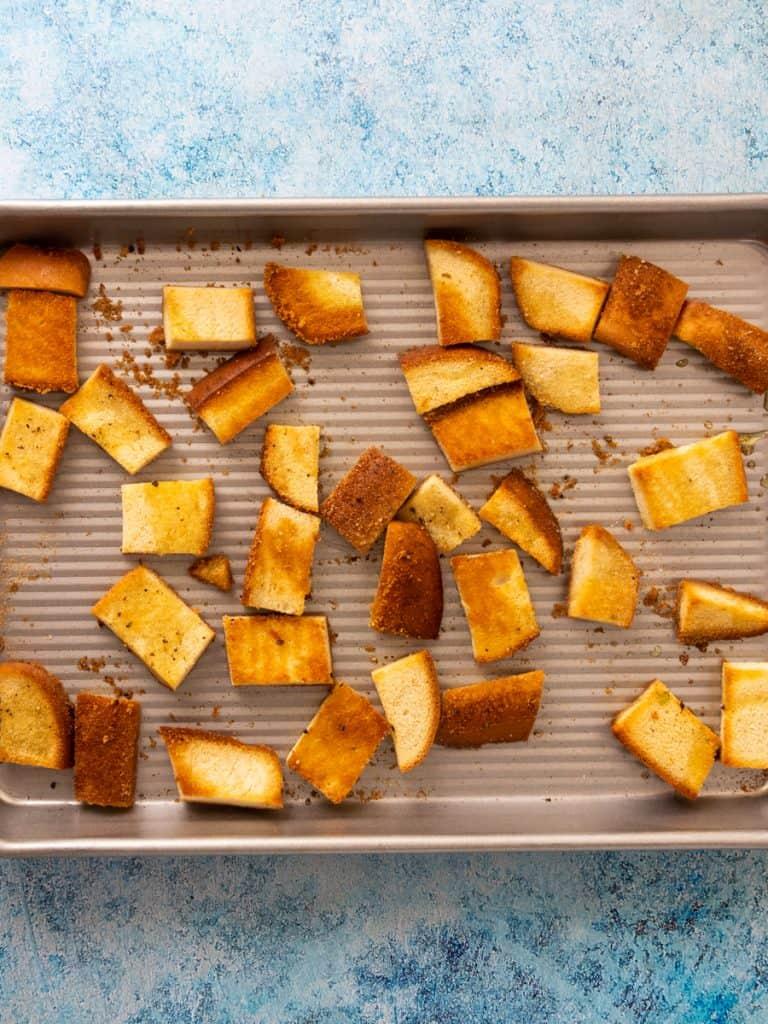 Gluten Free Greek-Style Panzanella Salad croutons on pan