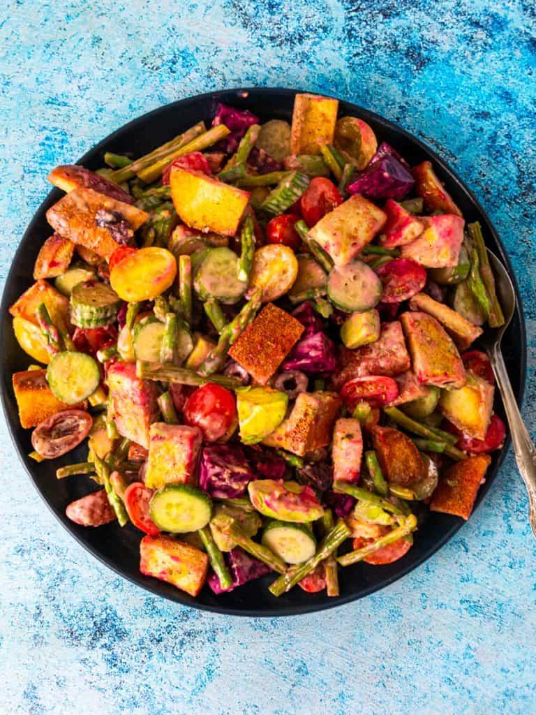 Gluten Free Greek-Style Panzanella Salad on serving dish