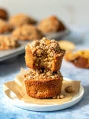 gluten free apple muffins stacked with bite taken out