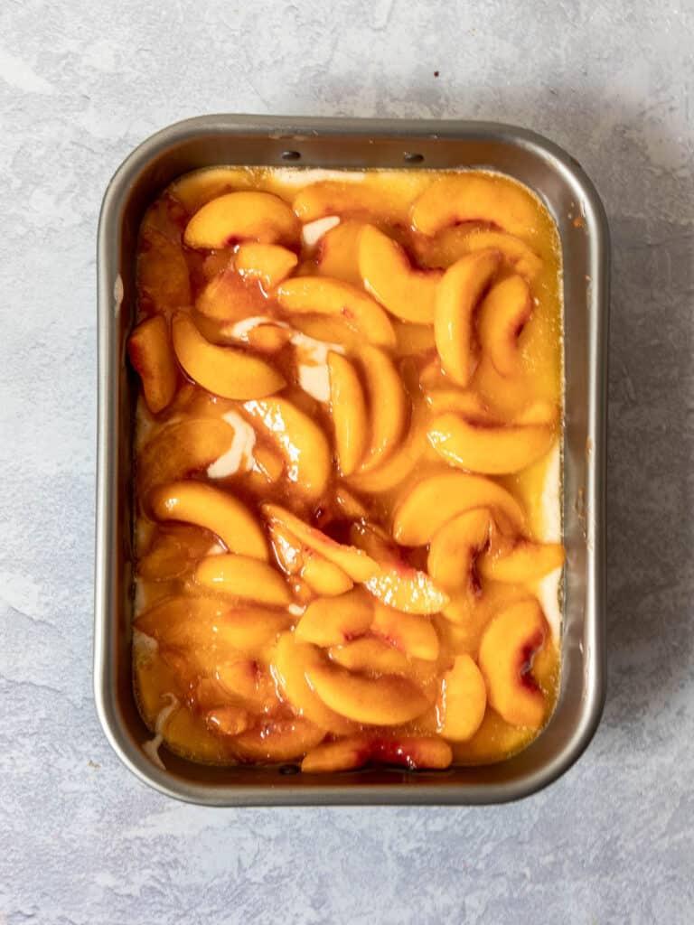 gluten free peach cobbler in pan before baking