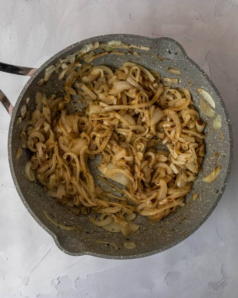 cooked onions in a pan