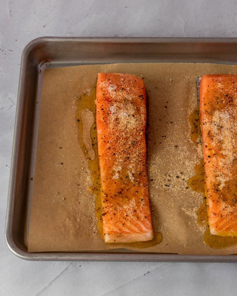 raw salmon in a half sheet pan