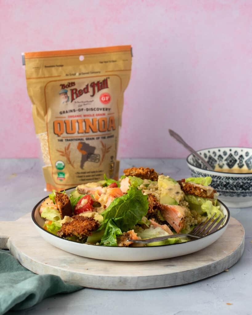 Salmon Quinoa Caesar Salad with quinoa packaging