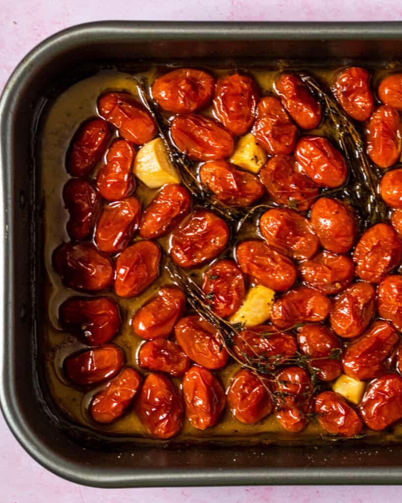 roasted confit tomatoes and garlic in a pan
