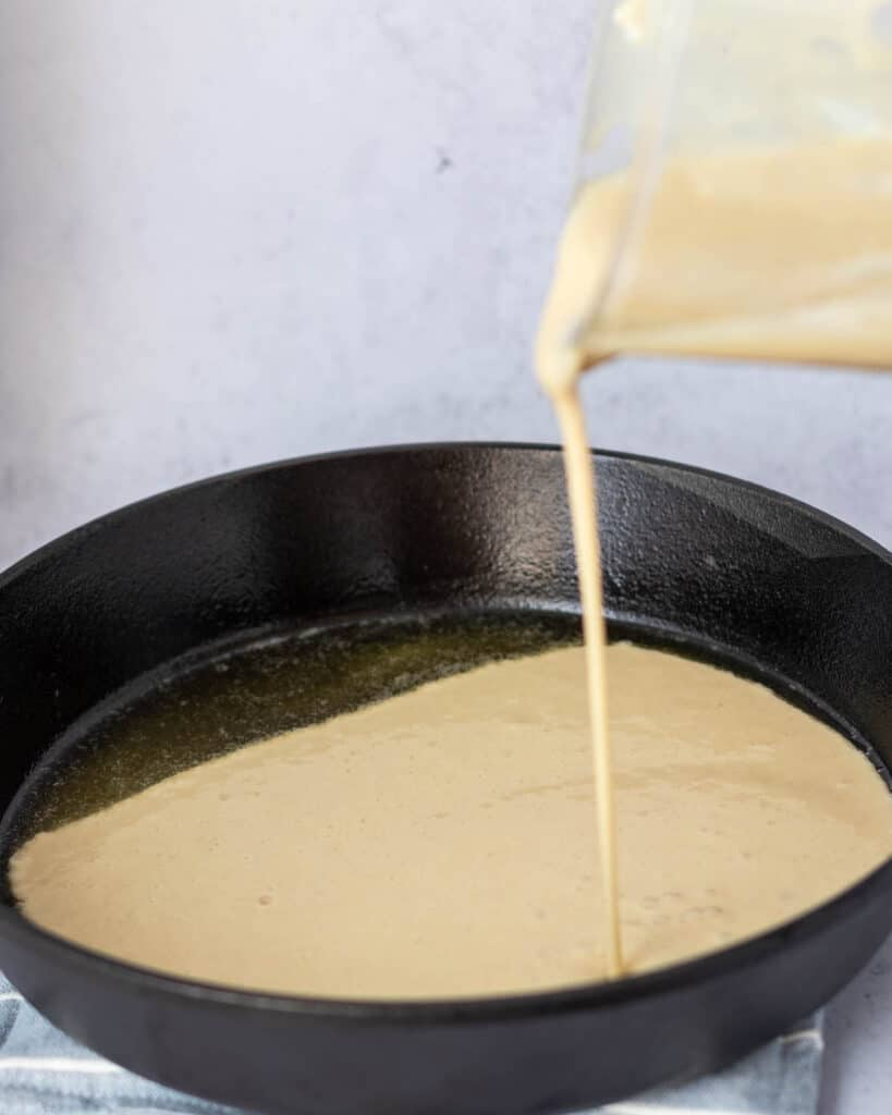 add batter to the cast iron pan